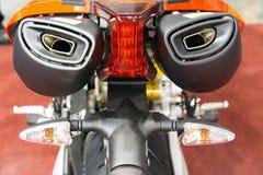 Scarichi del motociclo da dietro Immagine Stock Libera da Diritti