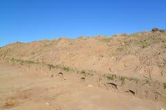 Scarichi del terreno argilloso sulla costruzione di strade Fotografia Stock Libera da Diritti