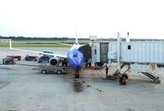 Scarico dell'aeroplano Immagini Stock Libere da Diritti