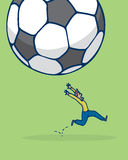 Scaried man escaping from falling soccer ball Stock Photo