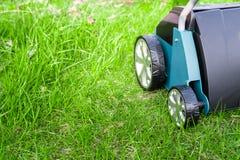 Scarifier on green grass. Work in the garden. Scarifier Royalty Free Stock Image