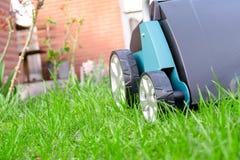 Scarifier on green grass. Work in the garden. Scarifier Stock Image