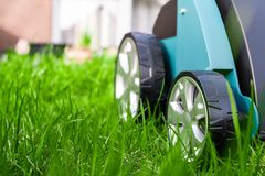 Scarifier on green grass. Work in the garden. scarifier.  royalty free stock images