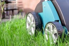 Scarifier on green grass. Work in the garden. Scarifier Stock Photography