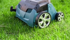 Scarifier on green grass. Work in the garden. scarifier.  royalty free stock photography