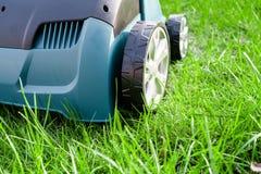 Scarifier on green grass. Work in the garden. scarifier.  Stock Photography
