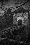 Scaring old castle in a storm weather. B&W graphical image of scaring old castle in a storm weather Stock Photography
