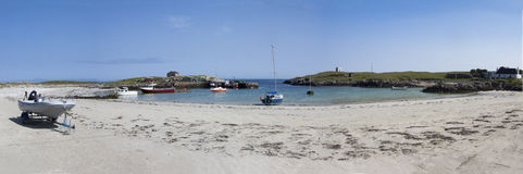 Scarinish Harbour Tiree Scotland. Panorama of the small harbour at Scarinish on the island of Tiree In the Hebrides Western Scotland royalty free stock image