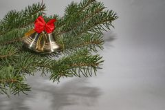 Jingle bells with red bow and Christmas tree. Stock Photography