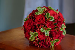Scarlet  bouquet of the bride Royalty Free Stock Photo