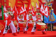 Scarlet flags and red and gold drums Stock Photos