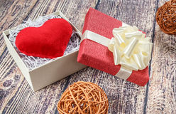 Scarlet heart groom in a box as a gift for a wedding. Royalty Free Stock Photo