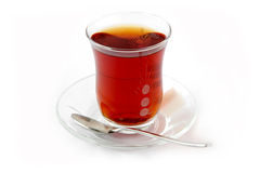 Scarlet, hot and sweet tea. A cup of well steeped Turkish tea with cube sugar Royalty Free Stock Photo