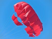 Scarlet Marine parachute. Flies against the sky Stock Photos