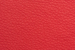 Scarlet Red Artificial Leather Background Texture Close-Up. A close-up shot of scarlet artificial leather background texture Royalty Free Stock Image