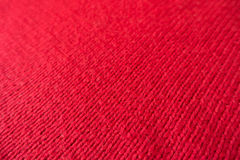 Scarlet red handmade fabric knitted by stocking stitch Royalty Free Stock Image