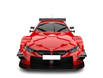 Scarlet red modern super race car - front view. Isolated on white background Stock Images