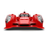 Scarlet red racing super car - front view. Isolated on white background Stock Photo