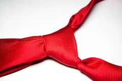 Scarlet red tie with knot Stock Images