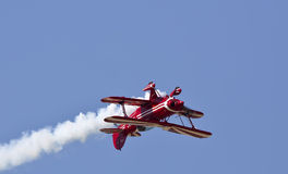 Scarlet Rose Upside Down Flight. A show airplane is flying upside down Royalty Free Stock Photos