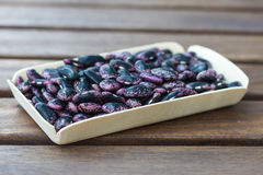 Scarlet runner beans on a wooden table Stock Photography