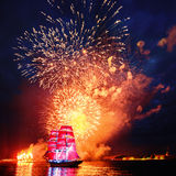 Scarlet sails. A symbol of graduates in St. Petersburg. Fireworks on the river Neva on a crimson parusnika. 2013 . Photo taken on: June 24th, 2013 stock images