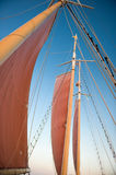 Scarlet sails. On masts against the blue sky Royalty Free Stock Photos
