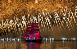 Scarlet sails. ST.PETERSBURG, RUSSIA - JUN 24, 2013: Light show and firework with a frigate with scarlet sails floating on the Neva River Stock Photos