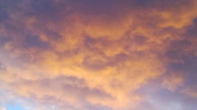 A scarlet sky. Scarlet sky with clouds during sunset Royalty Free Stock Image