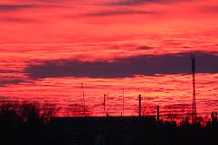 Scarlet sunset with evening clouds Royalty Free Stock Images