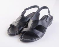scarpa o le scarpe nere degli uomini di colore su un fondo Immagine Stock Libera da Diritti