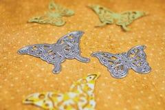 Scarpbooking die-cutter butterfly shape. Scarpbooking metal die cutter with some butterfly shapes royalty free stock image