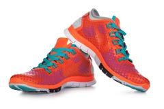 Scarpe arancio di sport Fotografie Stock
