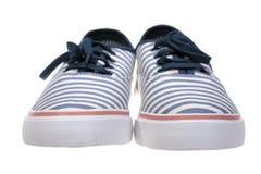 Scarpe casuali del mocassino a strisce su bianco Fotografia Stock