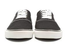 Scarpe da tennis nere della tela di canapa Fotografia Stock