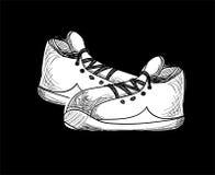 Scarpe da tennis. stile di schizzo. illustrazione di vettore Immagine Stock