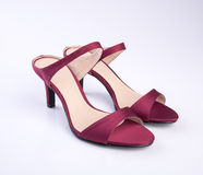 scarpe di colore rosso della donna o della scarpa su fondo Fotografia Stock