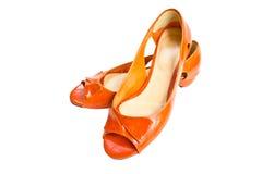 Scarpe di cuoio arancio. Immagini Stock