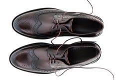 Scarpe di cuoio classiche degli uomini isolate su bianco Immagini Stock