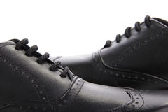 Scarpe di cuoio nere attraversate immagini stock libere da diritti