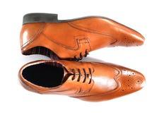 Scarpe di Tan sopra bianco Fotografia Stock