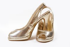 Scarpe dorate Fotografia Stock
