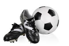 Scarpe e pallone da calcio in bianco e nero di calcio Fotografia Stock Libera da Diritti