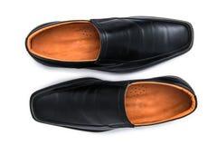 Scarpe lucide nere dell'uomo isolate Fotografia Stock