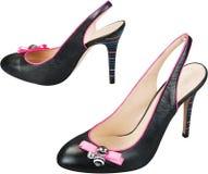Scarpe nere delle donne del tacco alto isolate su bianco Fotografia Stock