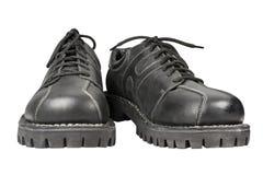 Scarpe nere su un fondo bianco fotografia stock