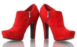 Scarpe rosse della donna Immagine Stock