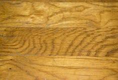 Scarred Oak Hardwood Floor Closeup. Scarred and scratched oak hardwood floor in light brown royalty free stock photography