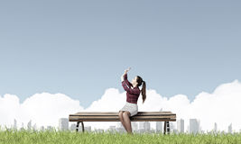 Scarred woman. Young woman sitting on bench afraid of something royalty free stock image