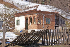 Scarsa casa isolata Immagine Stock
